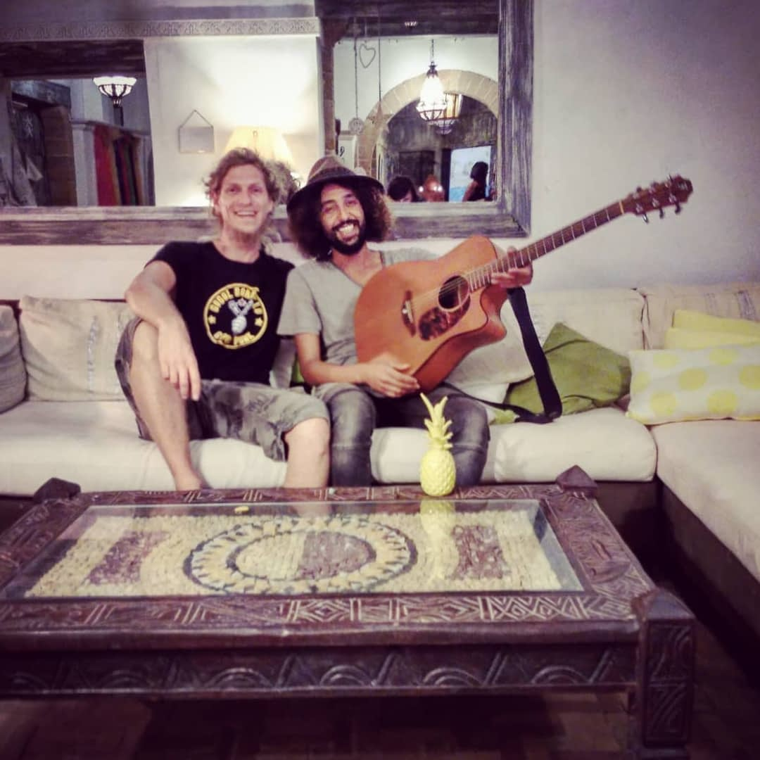Ady and simo on the couch after recording sessions with guitar | Hit the road music studio