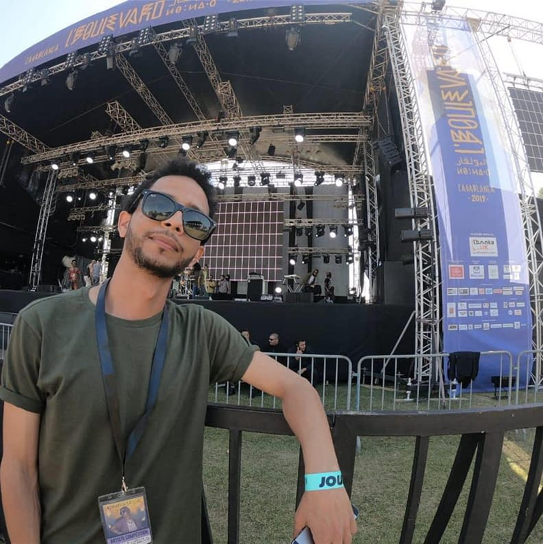 batal in front of stage