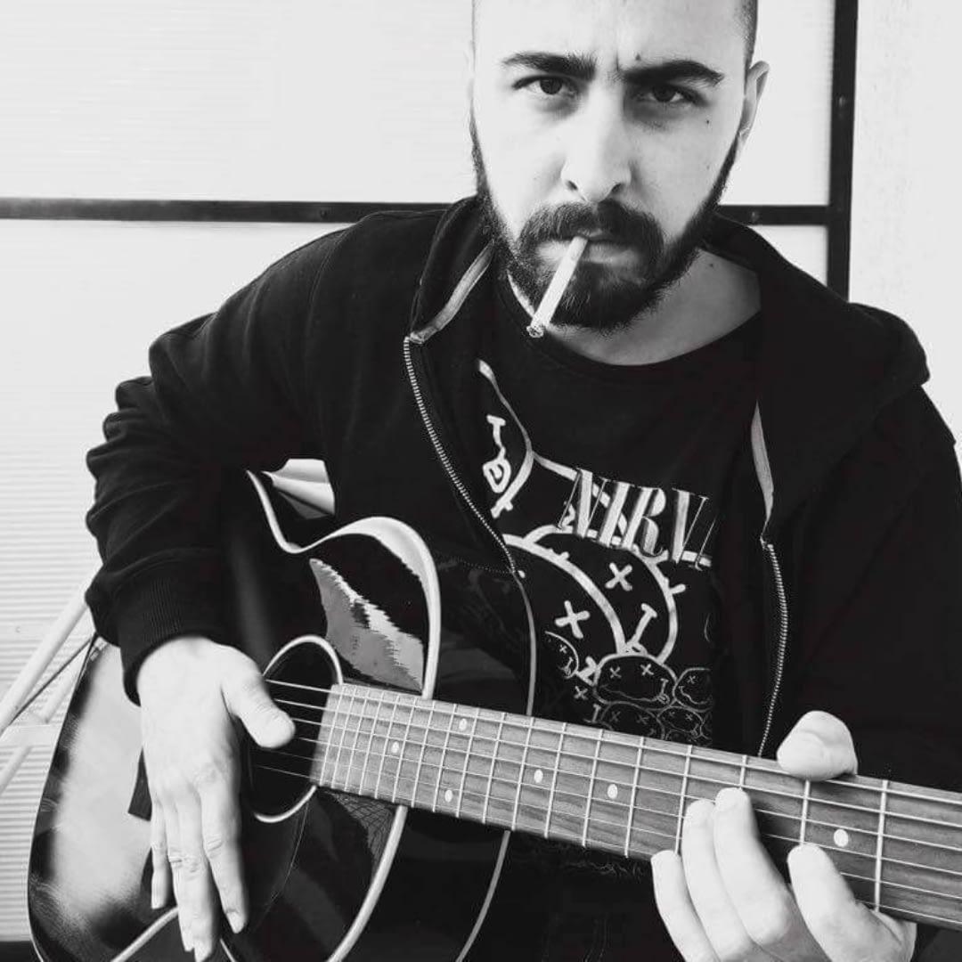 artist amyak with guitar